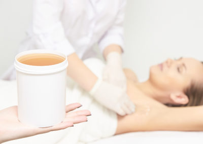 Sugar Hair Removal From Woman Body. Wax Epilation Spa Procedure.